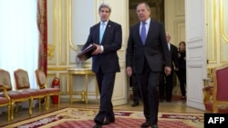 U.S. Secretary of State John Kerry (left) and Russian Foreign Minister Sergei Lavrov at the start of their meeting at the Russian ambassador's residence in Paris on March 30
