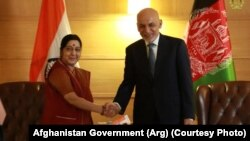 Afghan President Ashraf Ghani (right) shakes hands with External Affairs Minister Sushma Swaraj in New Delhi on October 24.