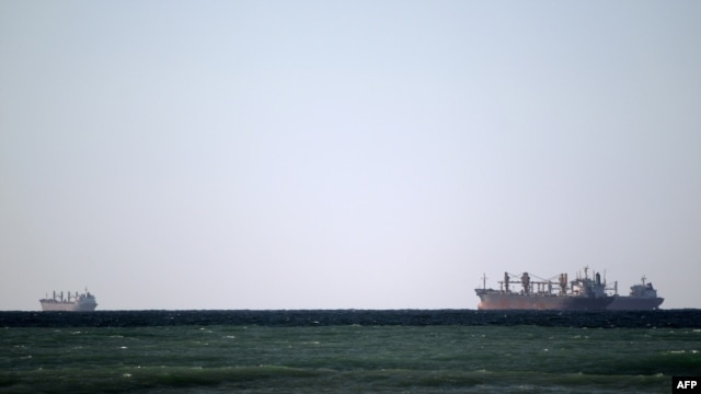 Oil tankers cruise out of the Strait of Hormuz, which Iran has threatened to shut.