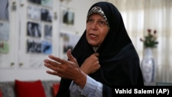 Faezeh Hashemi, the activist daughter of Iran's late President Akbar Hashemi Rafsanjani, speaks in an interview with The Associated Press, in Tehran, September 6, 2018