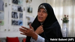 Faezeh Hashemi speaks to an interviewer in Tehran on September 6.