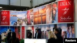 Visitors browse the exhibition stand of Iran at the International Tourism Trade Fair (ITB) in Berlin, March 9, 2016. File photo
