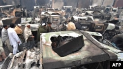 Burned-out trucks at a NATO terminal outside the city of Peshawar after a Taliban attack.