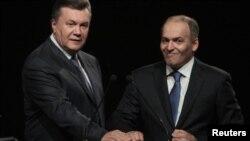 Виктор Янукович 9л) и Виктор Пинчук (п)