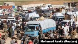 Сирийские беженцы возвращаются в страну из Ливана.