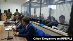 Defendants listen to the verdict in the case in Nur-Sultan on December 11.