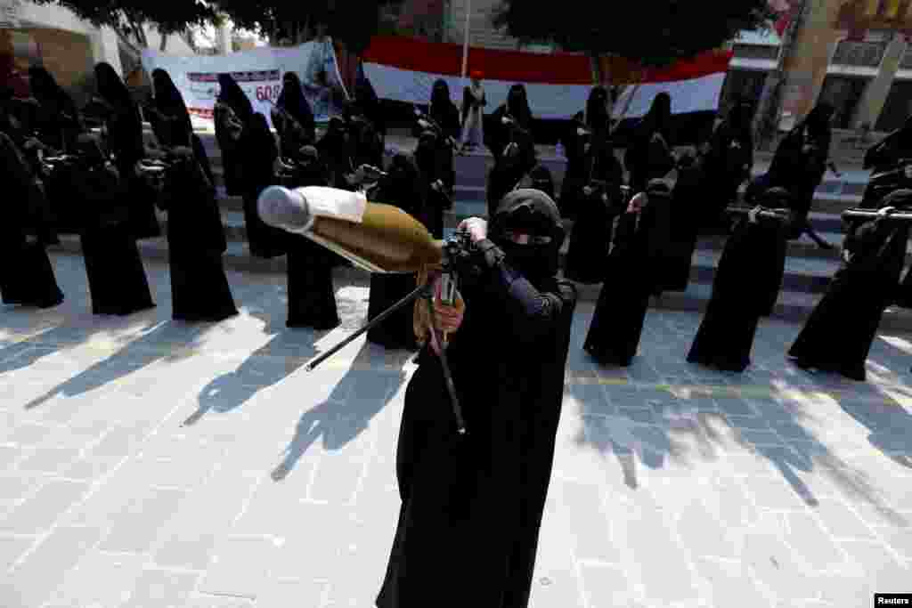 A woman loyal to the Houthi movement holds a rocket-propelled grenade launcher as she takes part in a parade to show support for the movement in Sanaa, Yemen. (Reuters/Khaled Abdullah)