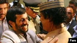Those were the days: Iranian President Mahmud Ahmadinejad (left) and then Libyan leader Muammar Qaddafi embrace at the United Nations