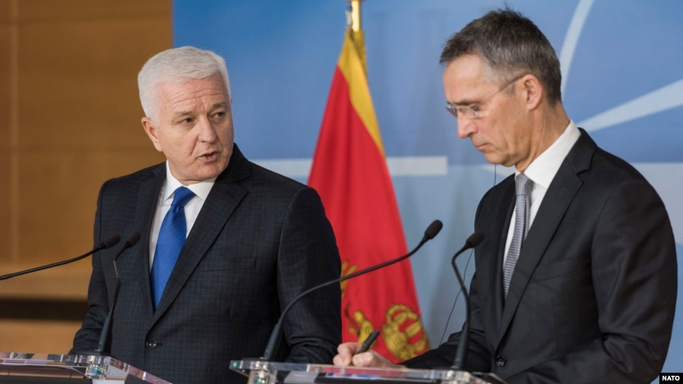 NATO Secretary-General Jens Stoltenberg (right) met with Montenegrin Prime Minister Dusko Markovic in Brussels on January 26.