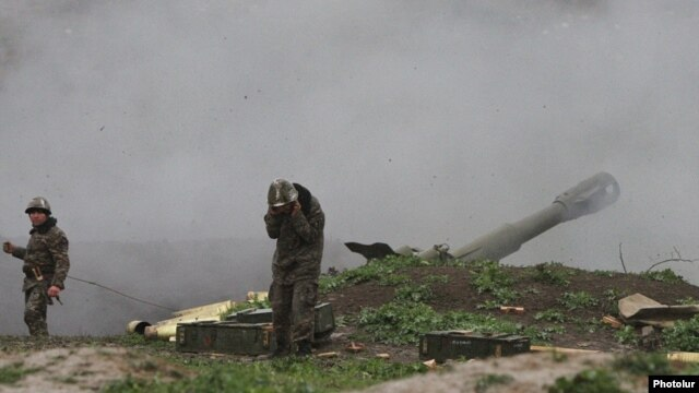 Karabakh Armenian troops fire rounds from a howitzer in the Martakert district of the breakaway rgion in early April.