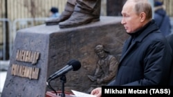 Russian President Vladimir Putin speaks during a ceremony to unveil a monument to Soviet-era dissident and writer Aleksandr Solzhenitsyn in Moscow.