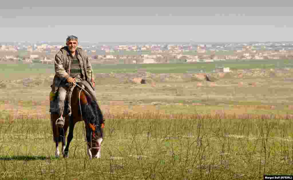A horseman rides near the remains of the town of Agdam. During the war, some 40,000 Azerbaijanis were driven out of the town, which was reduced to rubble by Armenian forces.
