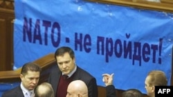 "Ukraine -- Deputies of the Regions Party and Communist Party block parliament's tribune by a banner reading ""NATO-no go"" during the opening of a new parliament session in Kyiv, 05Feb2008"