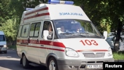 An ambulance transporting Yulia Tymoshenko arrives at the hospital in Kharkiv on May 9.