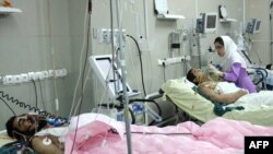 Wounded men at a hospital in Zahedan following the bomb blast