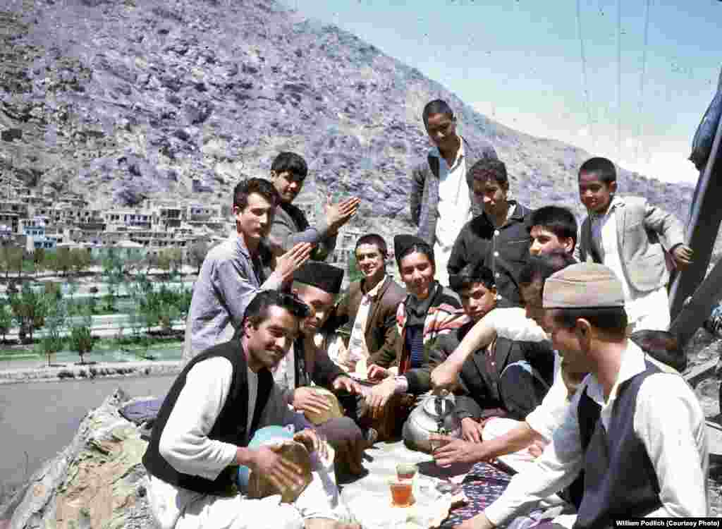 Young Afghans gather to share tea, sing, and play music.