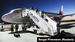 Saudi players leave their Rossiya Airbus A319 after a tense landing in Rostov-on-Don on June 19.