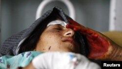 Одна з поранених в останньому ударі жінок у лікарні, фото 16 вересня 2012 року