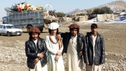 FILE: Some displaced Waziristan residents posing for a photo near the Gulan camp in Afghanistan's southeastern province of Khost.