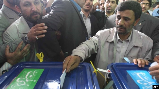 Happier days? Iranian President Mahmud Ahmadinejad (right) casts his vote at a polling station during previous parliamentary elections in 2008.