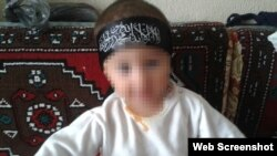 A young baby wearing an Islamic State headband. This photo was posted on the Russian social network VKontakte by a man named Artyom from Kazakhstan who says he is fighting for IS.