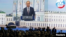 Russian President Vladimir Putin is seen on a giant screen at the St. Petersburg International Economic Forum 2015 (SPIEF 2015) on June 19.