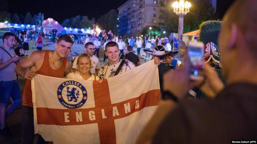 English fans arrive in volgograd amid tight security warm welcome english soccer fans pose for a photo at the official fifa fan fest in volgograd on m4hsunfo