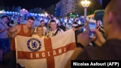 English soccer fans pose for a photo at the official FIFA Fan Fest in Volgograd on June 17.