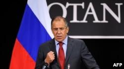 Сергей Лавров на пресс-конференции по итогам заседания Совета Россия – НАТО в Брюсселе. 19 апреля 2012 г