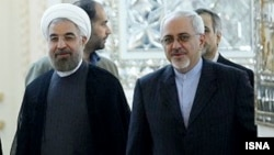 Iranian President Hassan Rohani (left) has handed over responsibility for nuclear negotiations to his foreign minister, Mohammad Javad Zarif (right), perhaps signaling a more flexible approach.