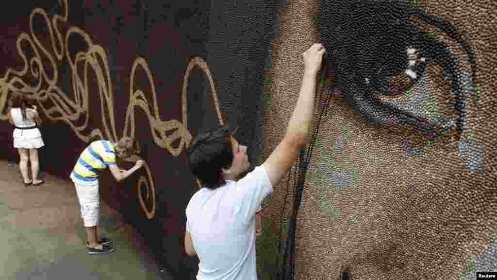 It is also being used as a venue for various creative performances and innovative art installations, such as this mural made completely out of coffee beans.