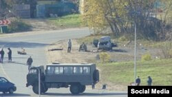 Police, who detained a third suspect alive, were searching a residential area of the city for possible suspects.