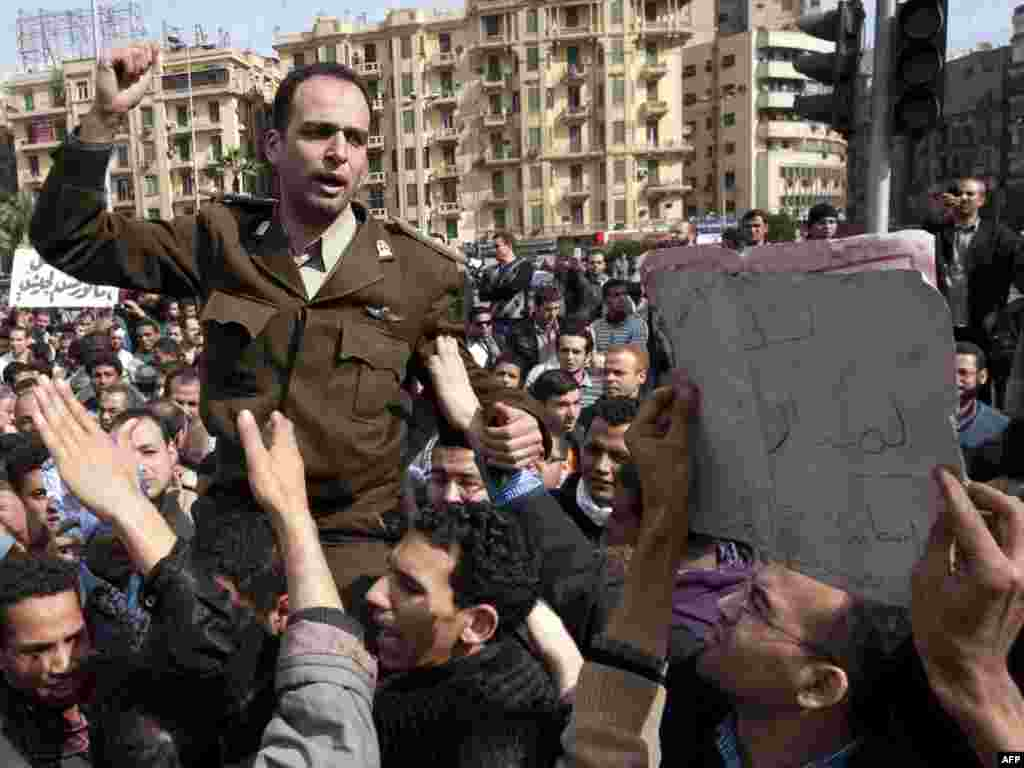 An army officer joins the demonstrators in Cairo's central Tahrir Square.