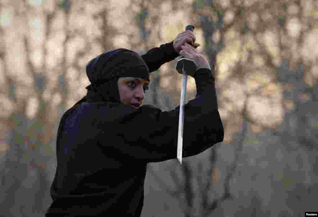 A woman participates in a ninjutsu sword drill.