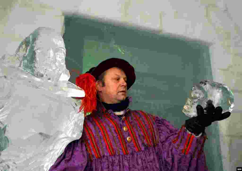 "Swedish actor and director Rolf Degerlund holds an ice skull during a performance of ""Hamlet"" at the Icehotel in Jukkasjarvi, northern Sweden."