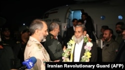 One of five freed Iranian security personnel who had been held by jihadists for a month in Pakistan, is received by military officers and media upon their arrival at an undisclosed location in Iran, November 22, 2018