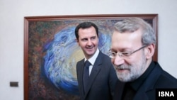 Syrian President Bashar al-Assad (left) meets in Damascus with Ali Larijani, Iran's parliament speaker, on December 21.