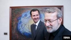 Syrian President Bashar al-Assad (left) meets in Damascus with Ali Larijani, Iran's parliament speaker, on December 21.