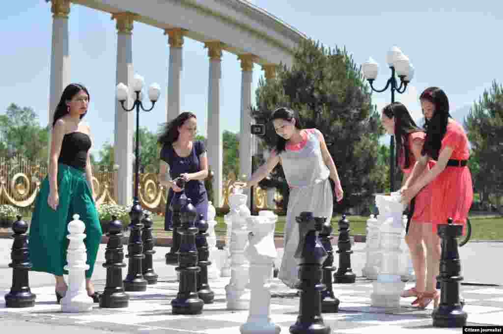 Playing chess in the park.