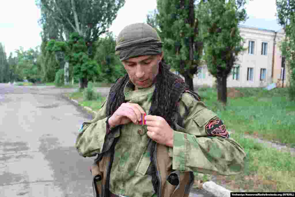 "Fighter ""Yaga"" shows his combat medal."