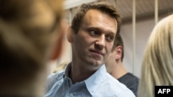 "A lawyer for Aleksei Navalny says it is ""very strange"" to issue a suspended sentence, which means the convict is not jailed, and at the same time order house arrest."