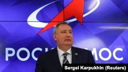 NASA called off a visit by Dmitry Rogozin, chief of Russia's Roscosmos agency, after an outcry by U.S. lawmakers.