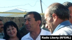 Armenia -- Opposition activist Zhora Sapeyan (C) is greeted by friends outside a prison in Artik, 29July 2010.