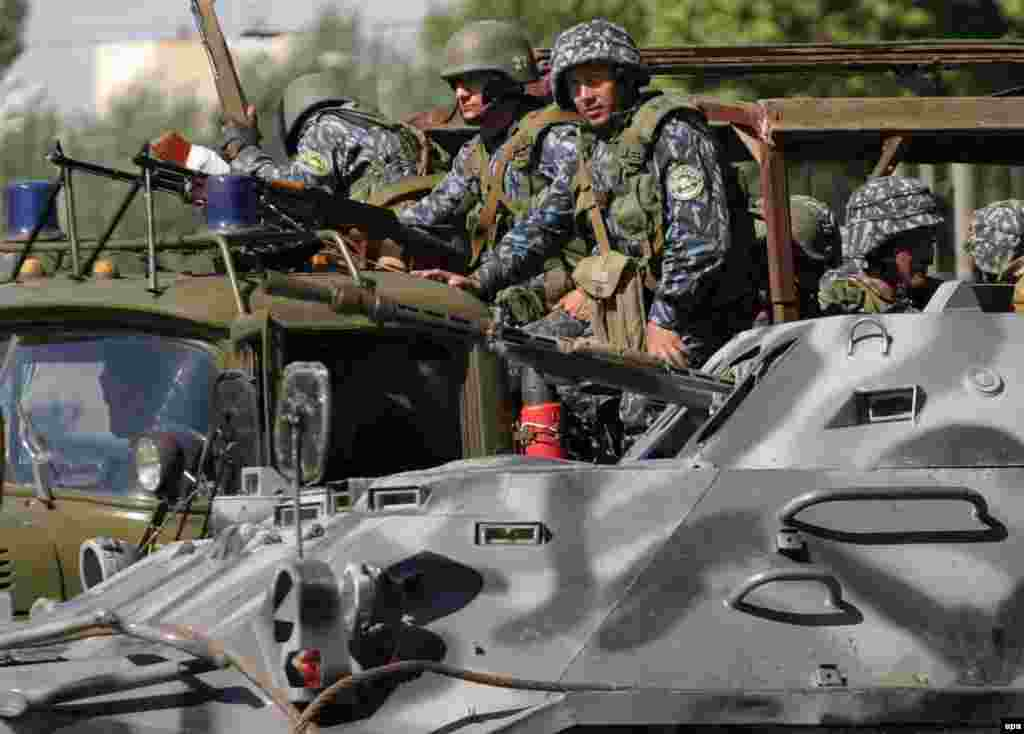 Special forces patrol the streets of Andijon in the aftermath of the brutal crackdown - On the night of May 12, 2005, armed men took over the seat of the regional administration in the Uzbek city of Andijon and assaulted a military garrison and a prison, seizing weapons and freeing prisoners. The following day, a huge demonstration gathered in the central square. The Uzbek government responded by sending in troops and armor.