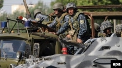 Uzbek special forces patrol the streets of Andijon on May 17, 2005.