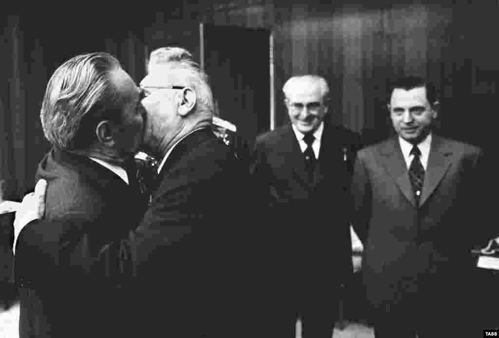 "Soviet leader Leonid Brezhnev and Nikolai Podgrony, the chairman of the Presidium of the Supreme Soviet, are locked into a ""socialist fraternal kiss"" inside the Kremlin in 1975. Homosexuality was made illegal by Stalin in 1933. The law could punish gay men with up to five years hard labor. Lesbianism was never criminalized but thorazine, an early antipsychotic medication, was recommended to ""cure"" gay women."