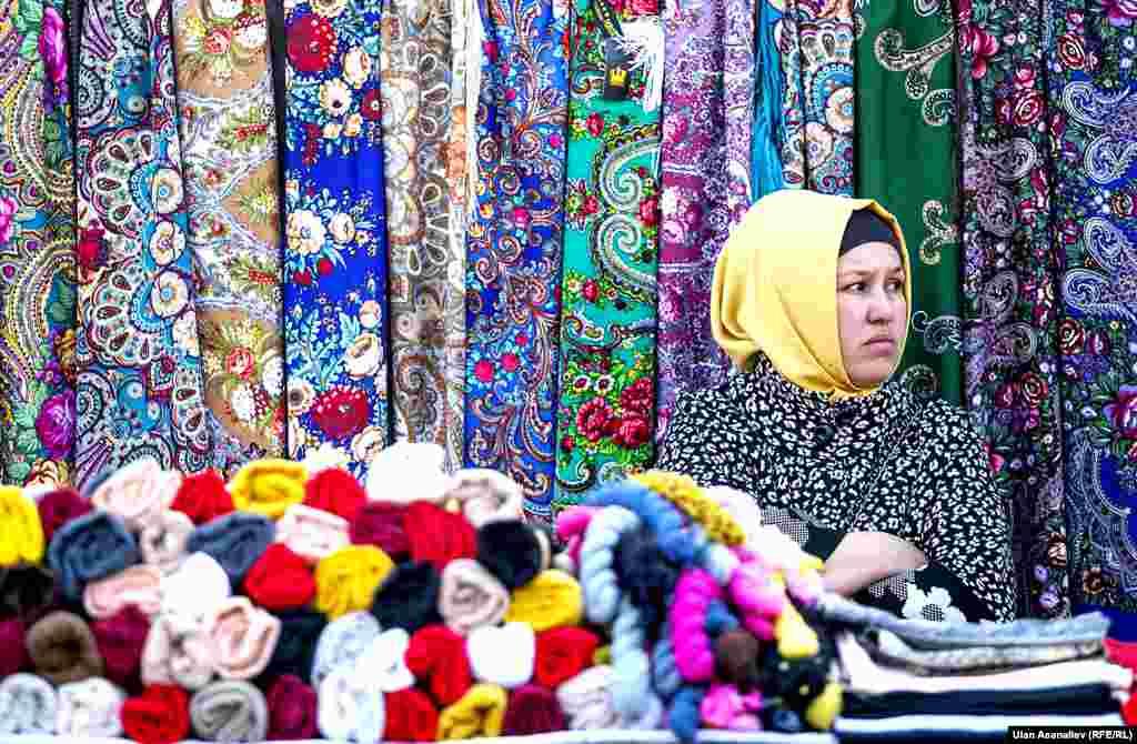 A textile seller in Bishkek, Kyrgyzstan