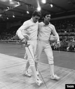 The U.S.S.R.'s fencing gold medalist Viktor Krovopuskov (right) and silver medalist Mikhail Burtsev at the 1980 Moscow Olympics