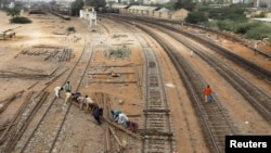 Labourers from the Pakistan Railways are seen working on railway tracks along City Station in Karachi, Pakistan on September 24.