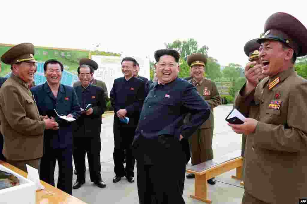 North Korean leader Kim Jong-Un (center) during an inspection of a Sinchang fish farm at an undisclosed location. (AFP)